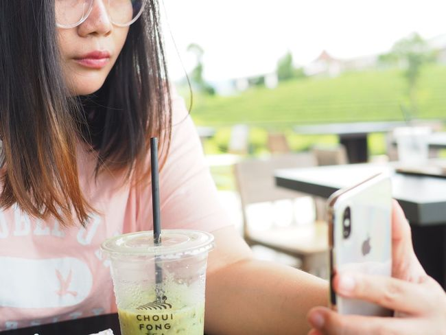 EyeEm Selects Women Drink Adult Refreshment Food And Drink One Person Hair Young Women Wireless Technology Real People Smart Phone Long Hair Technology Holding Close-up Young Adult Portrait Girls Child Hairstyle