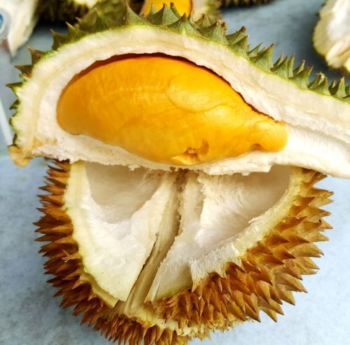 Food And Drink Green Color Durian King Of Fruit Yellow Green Thorns Delicious Yummy Soft ASIA Eat Travel Vacation Malaysia Holiday Smelly Freshness Holding Fruit Travel And Food Food Human Hand SLICE Freshness