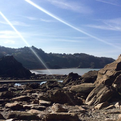 Sun Rays Cove Sea And Sky Blue Rocks