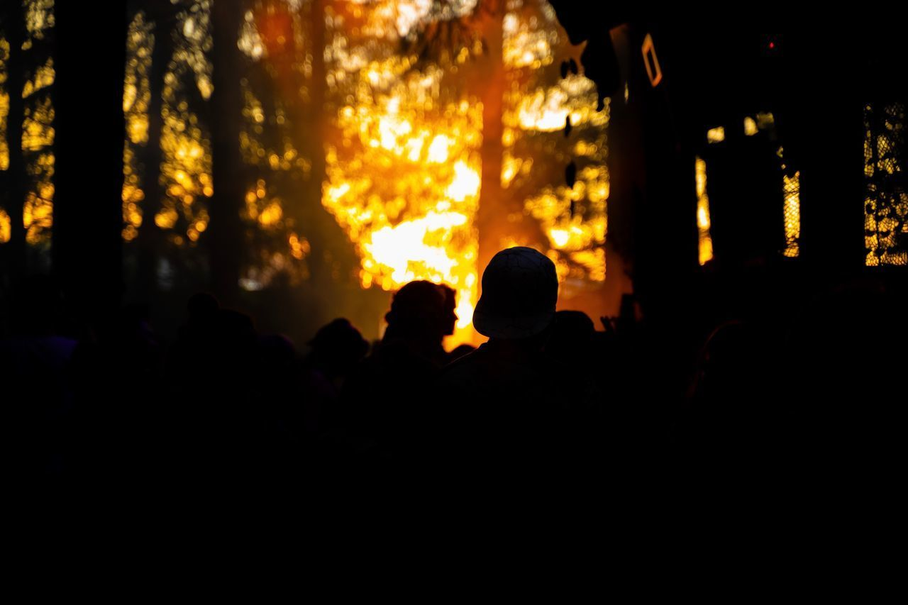 SILHOUETTE PEOPLE AT MUSIC DURING SUNSET