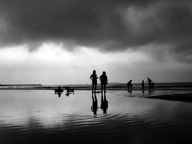 Black And White Art Artist Seascape Sea Ocean Beach Sand Family Could  Sky Light And Shadow Silhouette Outdoor Nature Landscape Storm Cloud Storm Travel Holiday Trip Relaxing Time Wave Water Chrildren Reflection