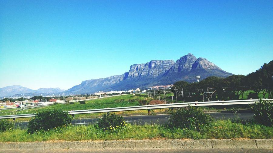 Driving to work on a hot summers day and getting this way view in the mix of things. Amazing is an understatement. Table Mountain Cape Town, South Africa Hot Day Summer ☀ Outdoors Nature Sky Road Green Trees View Scenery