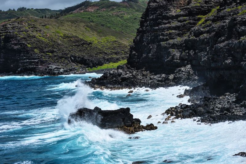 HAWAII Beauty In Nature Cliff Coastline Day Flowing Flowing Water Idyllic Landscape Motion Mountain Nature No People Non Urban Scene Non-urban Scene Outdoors Remote Rippled Rock Rock - Object Rock Formation Scenics Sky Tranquil Scene Tranquility Water
