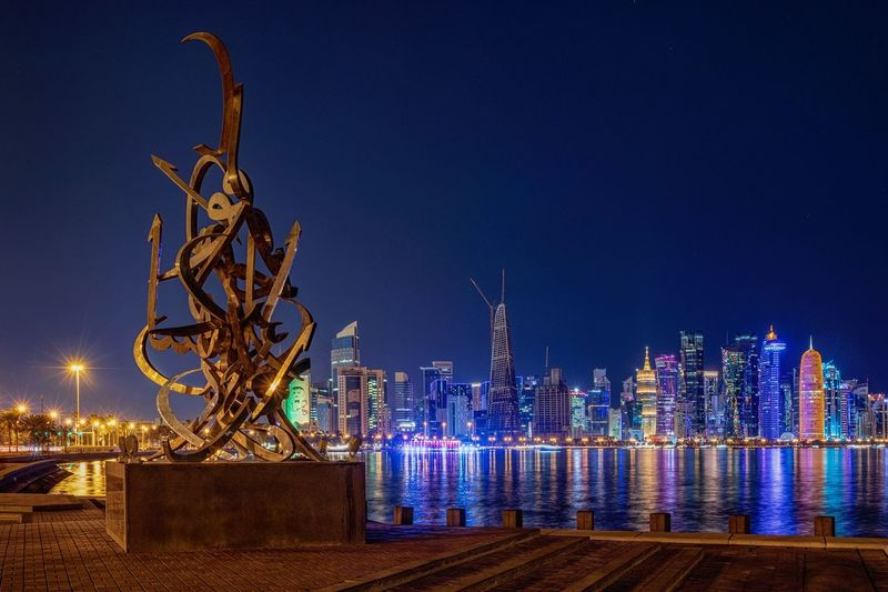 Night Cityscape for Doha Night Illuminated Architecture Built Structure Building Exterior Sky City Nature No People Clear Sky Lighting Equipment Building Water Blue Tower Travel Destinations Cityscape Decoration Outdoors