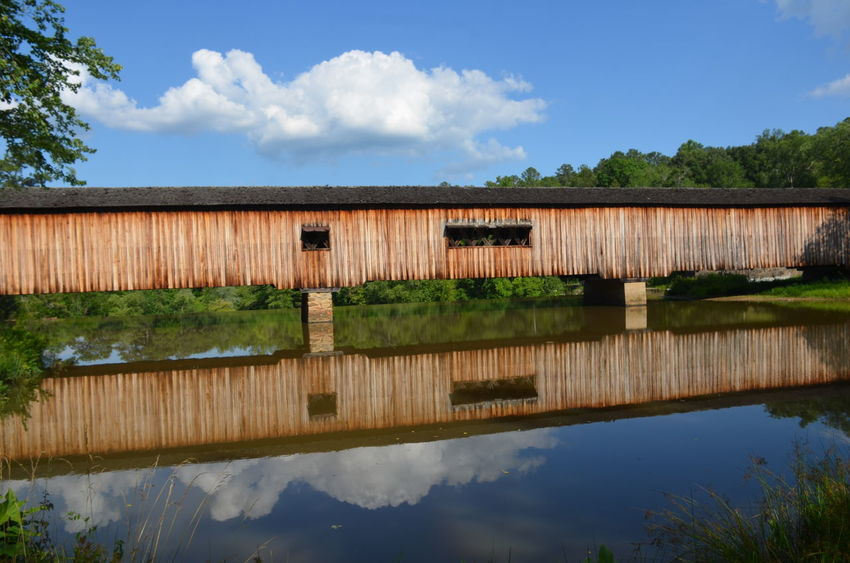 Architecture Beauty In Nature Building Exterior Cloud - Sky Covered Bridge CoveredBridge Day Growth Lake Nature No People Outdoors Plant Reflection Rural Scene Scenics Sky Tranquil Scene Tranquility Tree Water The Architect - 2017 EyeEm Awards Lost In The Landscape
