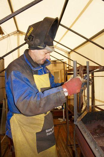 Manual worker working at metal workshop