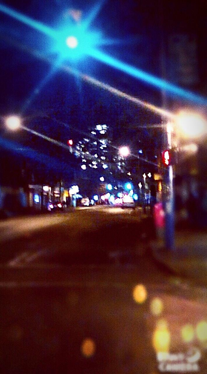 illuminated, night, lighting equipment, transportation, spotlight, nightlife, light beam, no people, road, architecture, outdoors, defocused, city, sky
