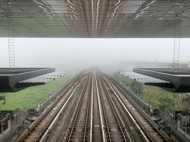Rail Transportation Track Railroad Track Public Transportation Transportation Architecture Diminishing Perspective Mode Of Transportation Day No People Built Structure High Angle View The Way Forward Travel Outdoors Direction Nature Station vanishing point Fog