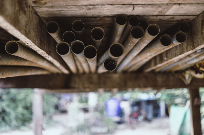 Plastic Pipes Water Pipe Water Pipes Architecture Built Structure Close-up Day No People Outdoors Pipe Plastic Pipe Water Pipeline Water Pipelines Wood - Material