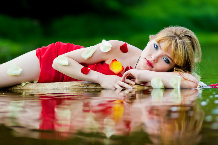 Blonde Blonde Girl Blue Eyes Blue Water Lying Down Lying In The Water Red Red Dress Red Fabric Red Lips Redhead River River Collection Riverbank Riverside Riverside Photography Rose🌹 Summer Summertime Sunset Young Adult Young Women Light And Reflection