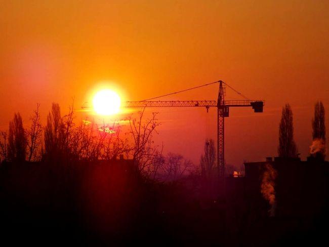 EyeAmNewHere Awakening Of Nature No People Tree Sunset Silhouette Sun Orange Color Sky Architecture Landscape Crane - Construction Machinery
