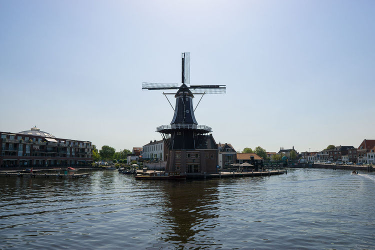 Water Architecture Sky Built Structure Waterfront Building Exterior Nature City Clear Sky River Day Building No People Transportation Copy Space Mode Of Transportation Outdoors Nautical Vessel Netherlands Holland Haarlem Mill Windmill Summer Urban
