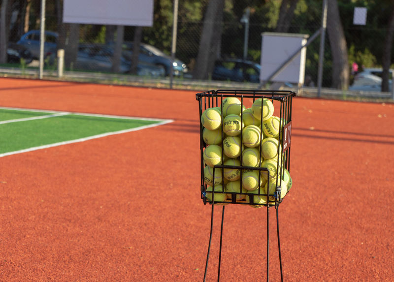 Sport Focus On Foreground Green Color Day No People Healthy Eating Ball Fruit Wellbeing Food Food And Drink Container Court Outdoors Tennis Freshness Large Group Of Objects Still Life Close-up Tennis Ball