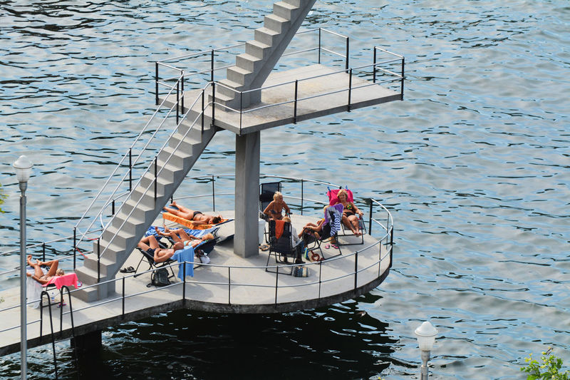A day at the lake, sunbathing - Como, Lombardy, Italy. Como Lake Day High Angle View Italia Italy Lake Lake Como Lario Leisure Activity Lifestyles Lombardia Lombardy Outdoors People Real People Water Waterfront Live For The Story
