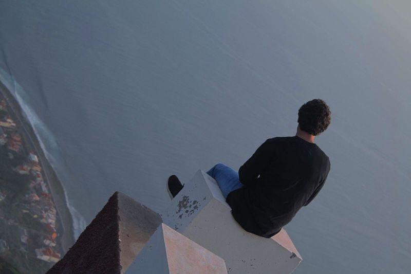 Man sitting on roof
