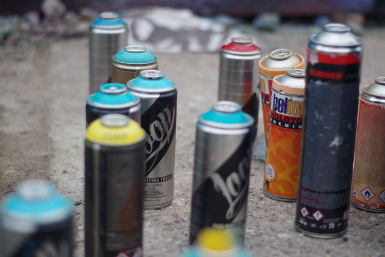 Close-up of multi colored bottles