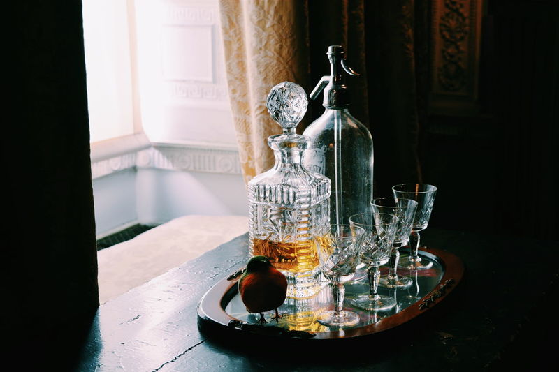 Alcohol in bottle on table