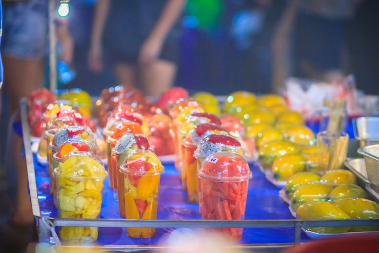 Fruit salad arranged in plastic cups for sale on street at Bangkok night market, Thailand. Sliced Fruit Segments Street Food Vendors Street Fruit For Sale Fruit Salad Mixed Fruits Night Market Night Market In Thailand Night Market Seller Night Market, Plastic Cup Sliced Fruit Sliced Fruits Street Food Street Food Market Street Food Of Thailand Street Food Stall Street Food Thailand Street Foods Street Foods Photography