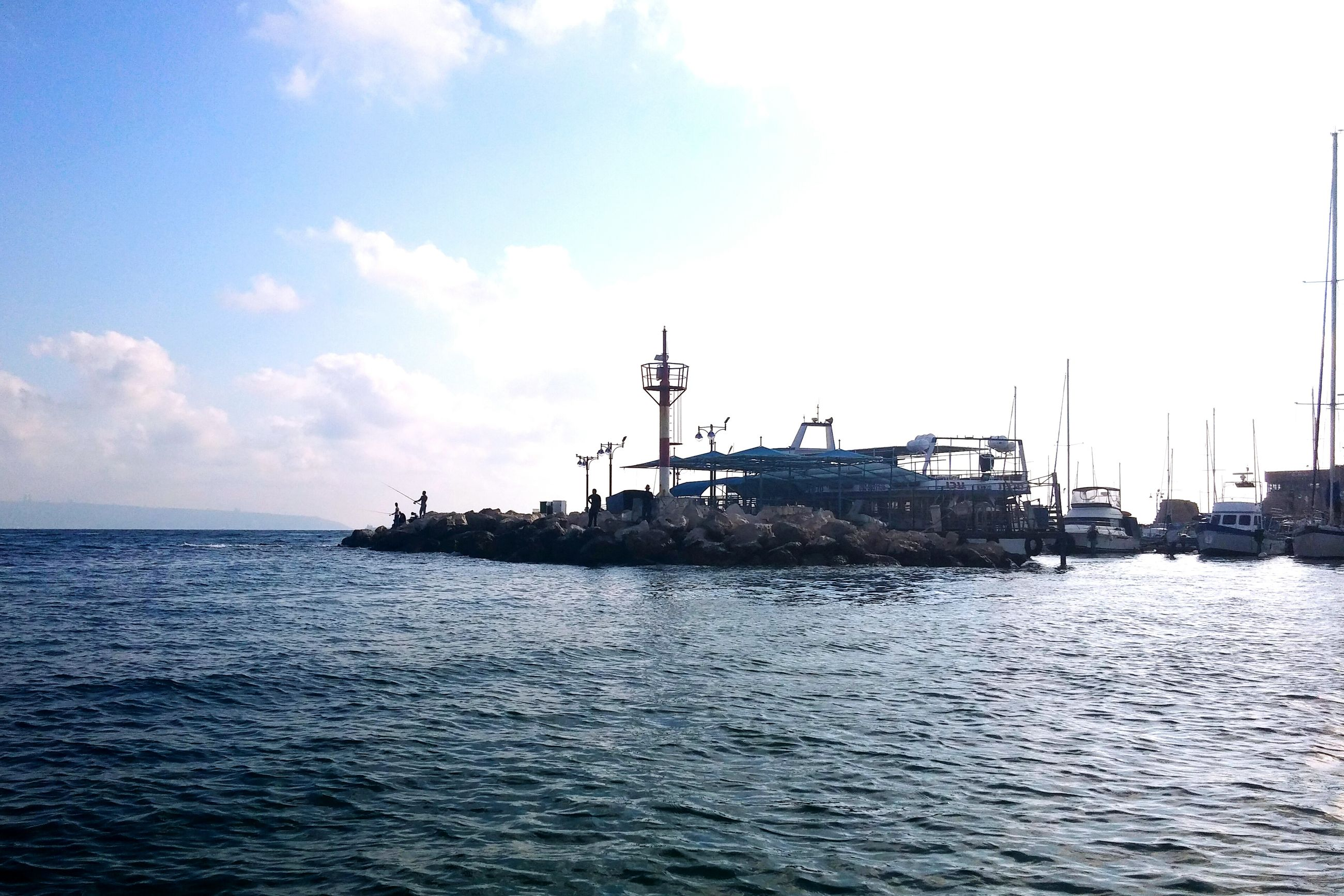 sea, water, waterfront, sky, horizon over water, rippled, tranquil scene, built structure, scenics, nature, tranquility, beauty in nature, building exterior, architecture, nautical vessel, day, outdoors, no people, cloud - sky, bird