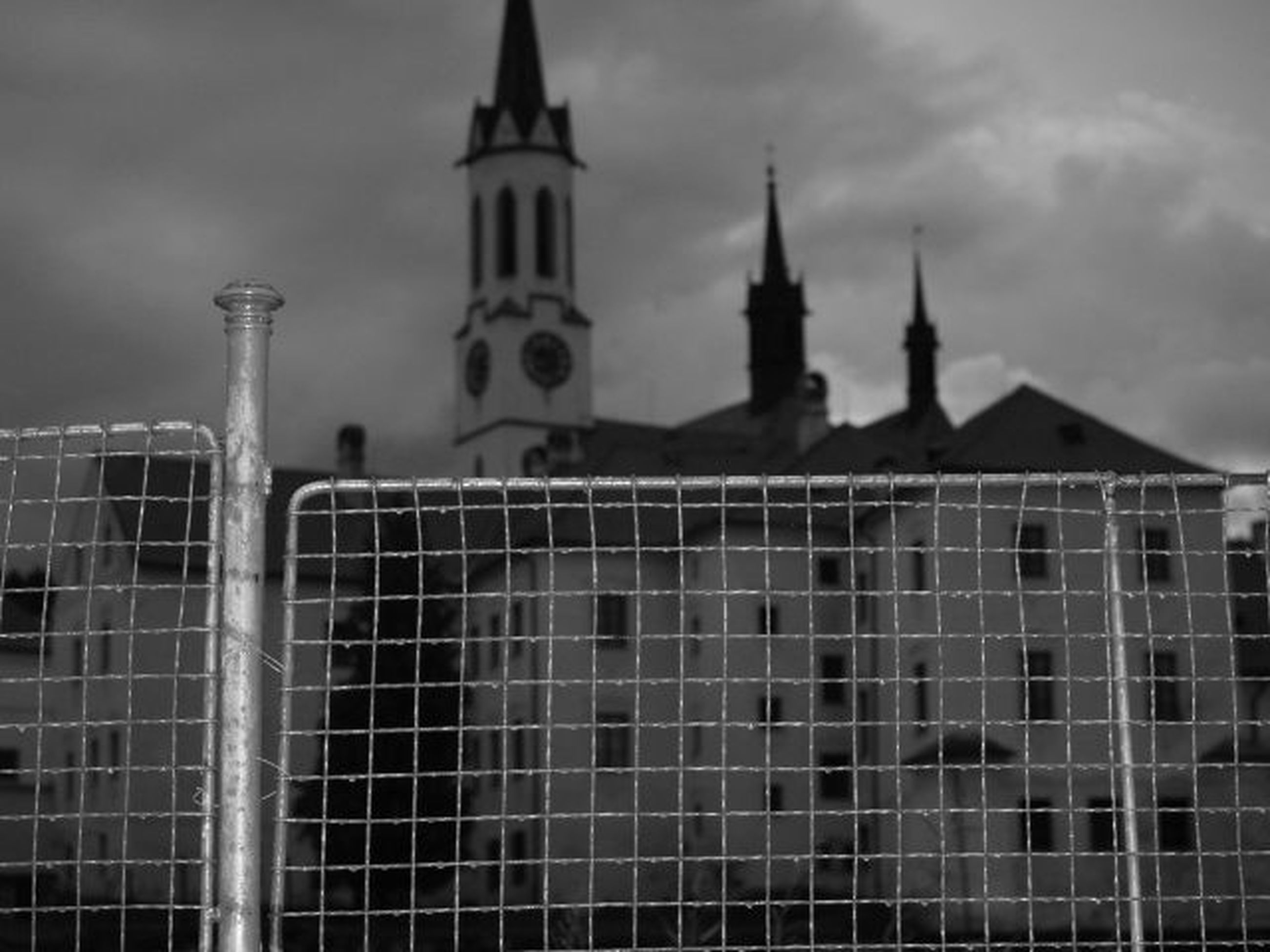 building exterior, architecture, built structure, religion, sky, place of worship, church, low angle view, tower, spirituality, city, cloud - sky, famous place, day, travel destinations, tall - high, outdoors, no people