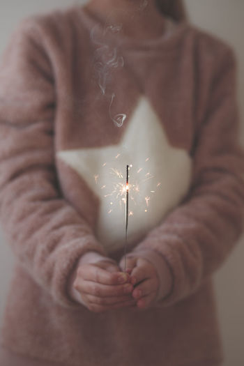 Close-up of girl holding sparkler