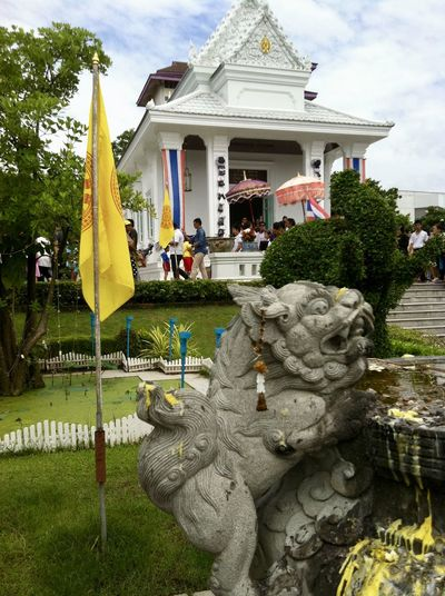 Ordination Ceremony in the Temple Architecture Building Exterior Built Structure Cloud - Sky Day Flag Lion Sculpture No People Ordination Ceremony Outdoors Place Of Worship Religion Sculpture Sky Spirituality Statue Thai Architecture Thai Temple Tree Wat Praram 9