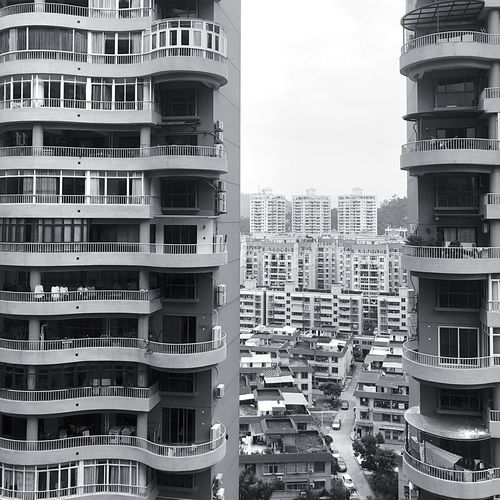 Gray Building Exterior Architecture Built Structure Building Residential District City No People Sky Window Tall - High City Life