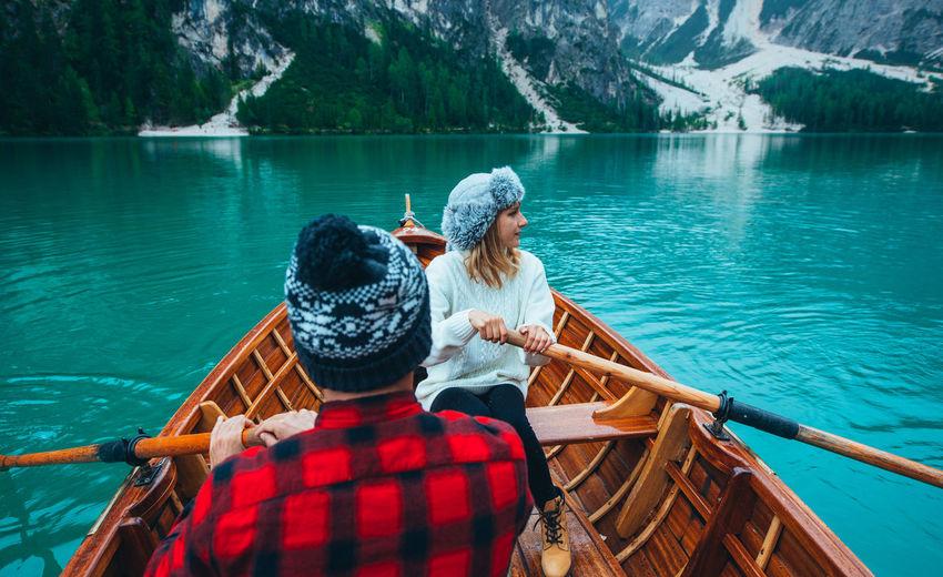 Friends sitting on boat in lake