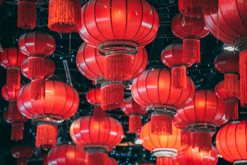 Low angle view of illuminated lanterns hanging at ceiling