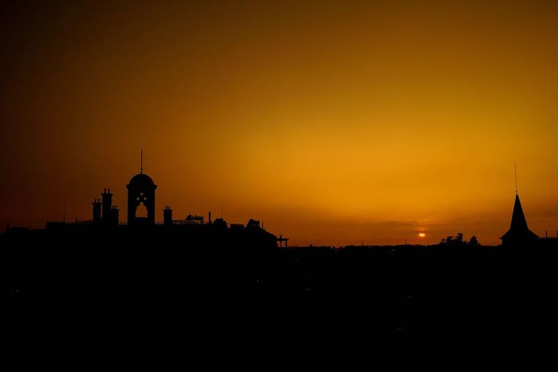 Silhouette of built structures at sunset
