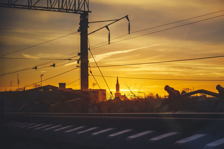 Morning skyline Nikon Z7 Z7 Europe Lithuania Lietuva Morning Skyline Travelling Morning Sunrise Sun Church Railway Sunset Sky Transportation Cloud - Sky Orange Color Cable Nature Connection Power Line  No People Mode Of Transportation Silhouette Electricity  Road Beauty In Nature Electricity Pylon Technology Outdoors Power Supply