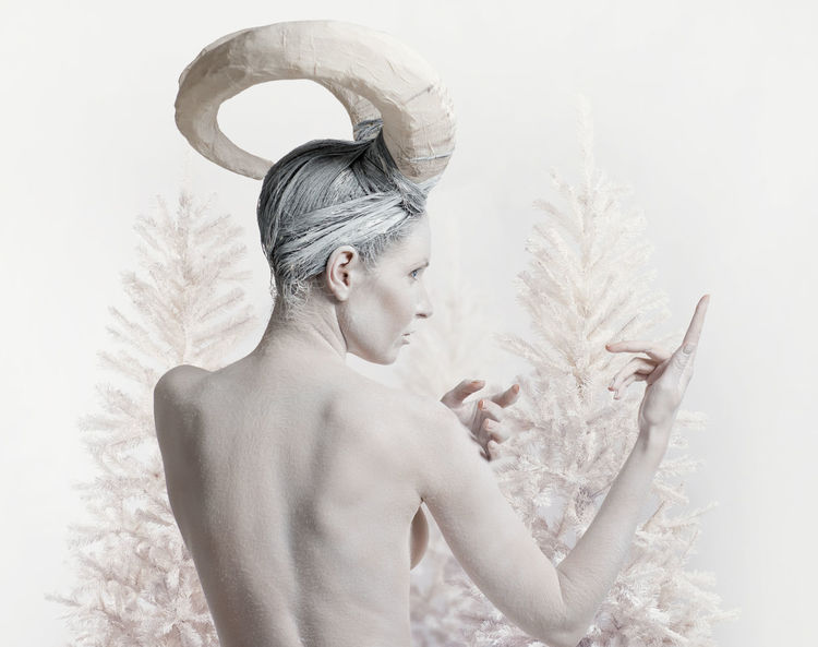 Female with goat body-art isolated on white. Dedicated to Chinese Horoscope 2015 - Year of the Goat (Sheep) Aries Back Goat Horns Horoscope  Trees Winter Woman Zodiac Sign Astrology Sign Beautiful Woman Body Paint Bodyart Character Christmas Tree Conceptual Female Horned Sheep Women