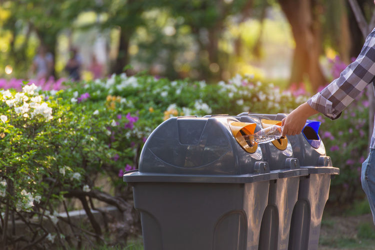 One Person Plant Day Focus On Foreground Holding Nature Real People Human Body Part Human Hand Flowering Plant Flower Growth Hand Lifestyles Outdoors Freshness Container Midsection Front Or Back Yard Gardening Trash Bin Recycle Environment