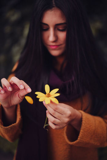Close-up of woman holding flower