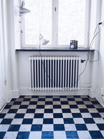 White Color Checked Pattern Indoors  No People Domestic Room Day Radiator Window Frame Kitchen Built Structure Simplicity Interior Design Squared Floor Window View Indoors  Window Architecture Home Interior Room White Low Section Empty Room