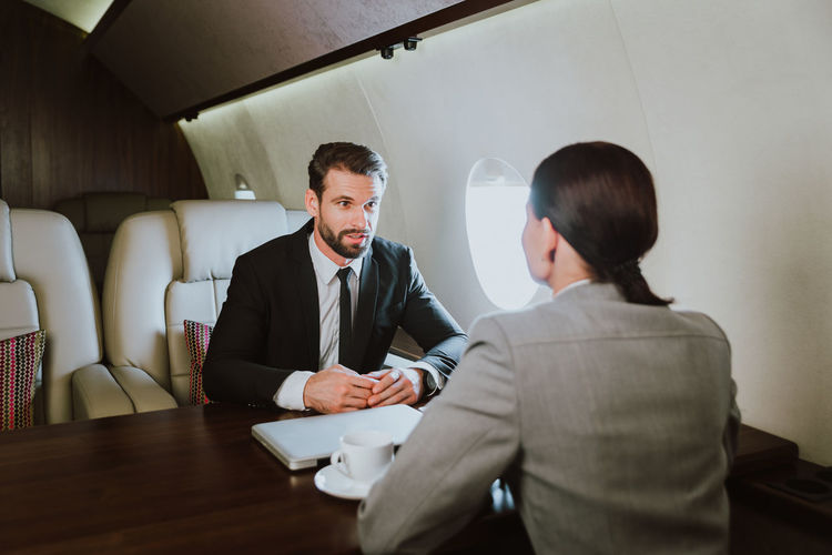 Business people sitting in airplane