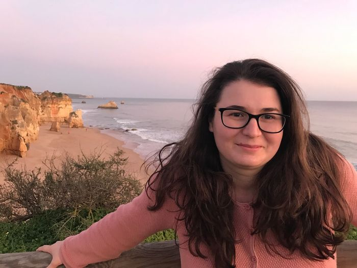 Portrait Of Young Woman At Beach During Sunset