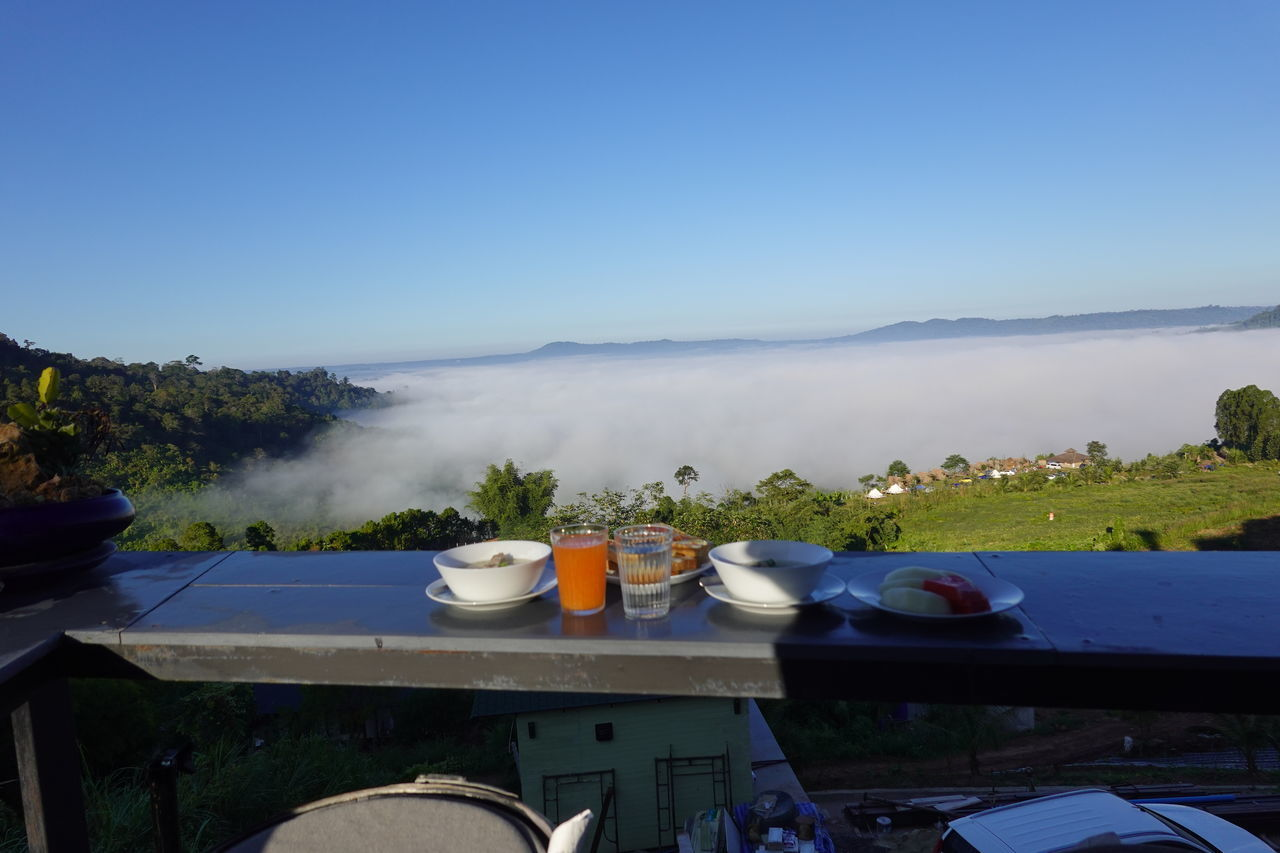 HIGH ANGLE VIEW OF FOOD ON TABLE AGAINST BLUE SKY