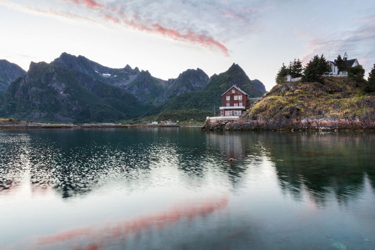 Amazing landscape from Lofoten - Norway Norway Reflection Architecture Beauty In Nature Building Exterior Built Structure Day House Lake Lofoten Mountain Mountain Range Nature No People Outdoors Red Sky Reflection Scenics Sky Summer Sunrise Sunset Tranquility Tree Water