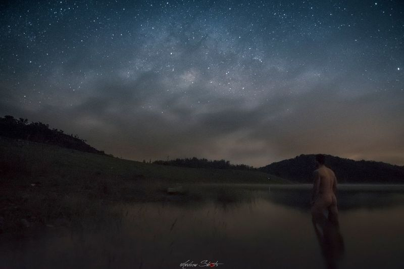 EyeEmNewHere Astronomy Night Nature Star - Space Reflection Space And Astronomy Sky Lake Milky Way Dark Landscape Beauty In Nature Galaxy Vacations Mountain One Person Tourism Space People Outdoors Long Goodbye