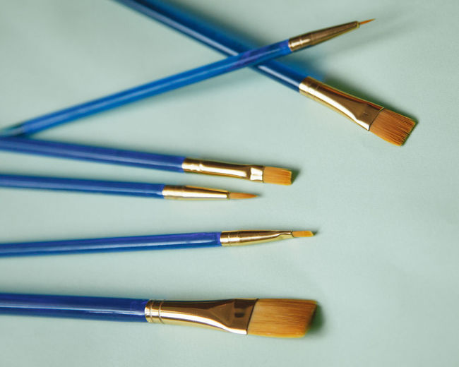 High angle view of colored pencils on white table