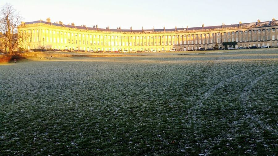 Bath Bath, UK Royal Victoria Park, Bath Park Outdoors Sunlight The Royal Crescent, Bath, UK Royal Crescent Architecture Frost Frosty Winter Cold Georgian Architecture No People Day Grass Dawn Sunrise Yellow Sunlight Misty Morning Cold Morning Cityphotography Frosty Grass Sunlight On Buildings