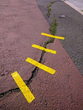 Road Asphalt Duct Tape Duct Tape Artwork Fixed Improvised No People Repair Yellow
