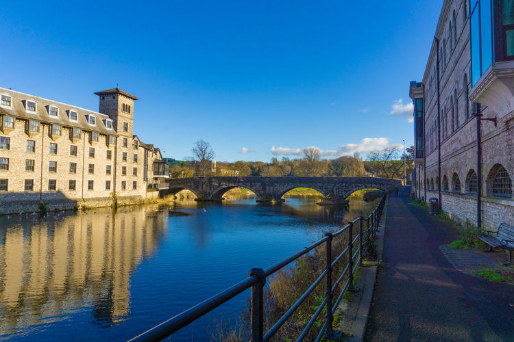 Cityscape of River Kent at Lound Road in Kendal, Cumbria, England in blue sky day Architecture Built Structure Building Exterior Bridge Sky Bridge - Man Made Structure Water Connection City Nature Building Transportation Blue No People River Railing Day Arch Arch Bridge Outdoors