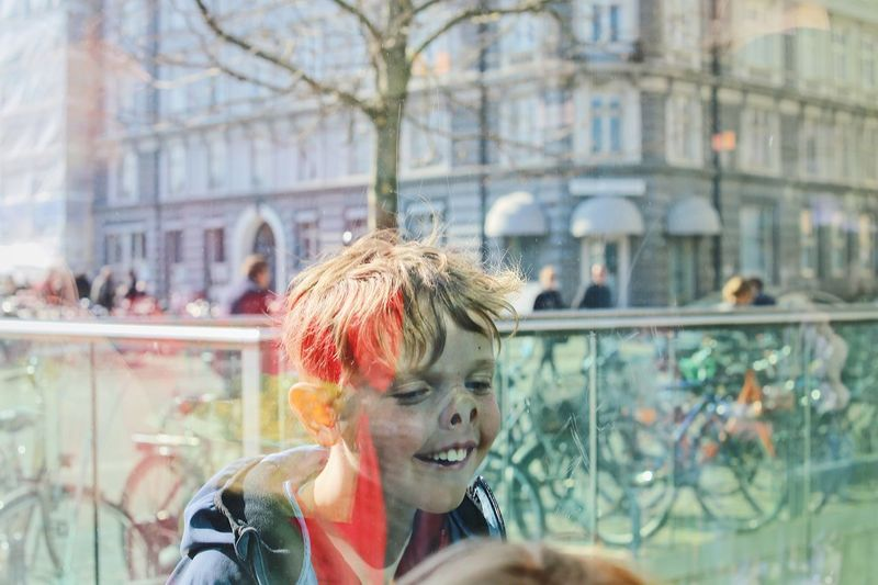 Doing faces to the other one indoors Full Frame Outdoors Indoors  Bicycles Traffic Funny Face Face Child Real People One Person Lifestyles Headshot Leisure Activity Day The Art Of Street Photography Portrait Window Front View Glass - Material Built Structure Transparent Building Exterior Outdoors Architecture Looking Hairstyle