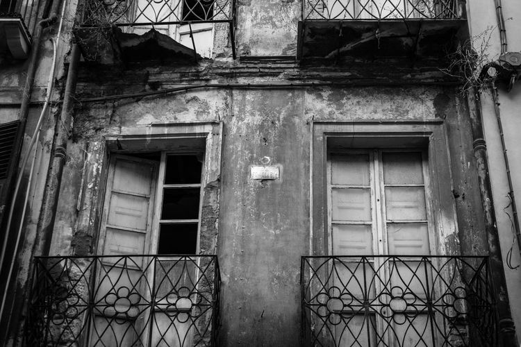 Low angle view of window of old building
