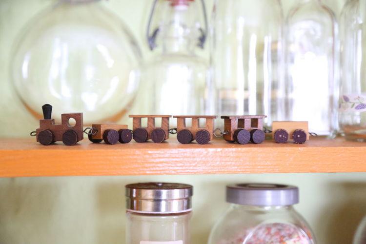 Close-up of toy train on shelf