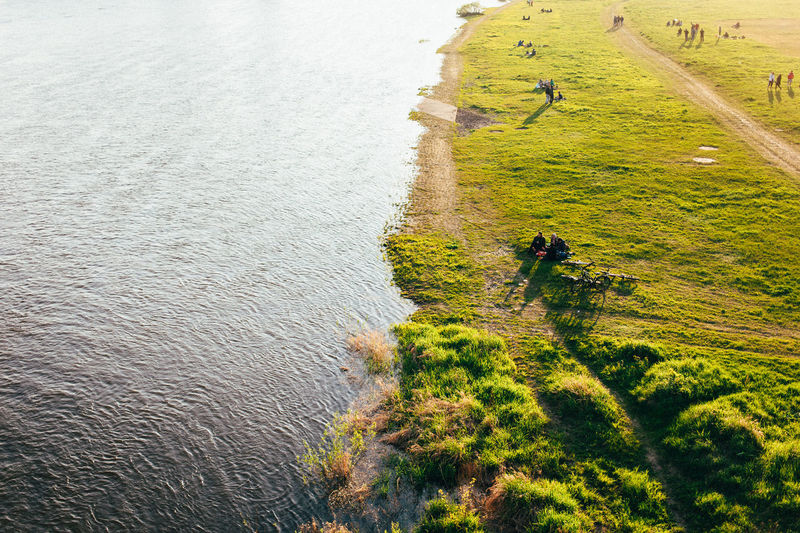 High angle view of man on river amidst field