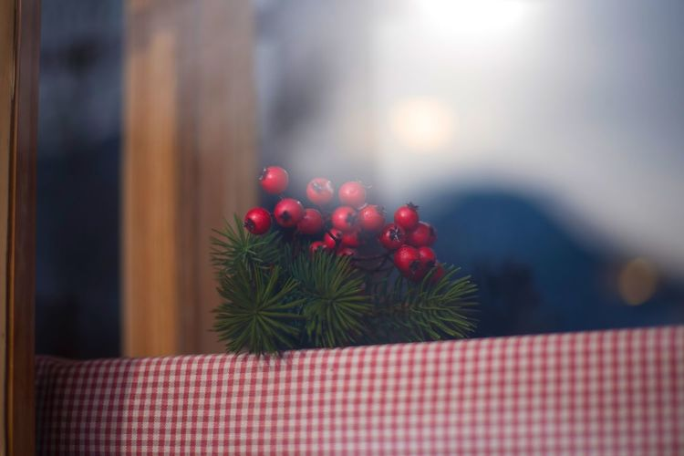 Close-up of christmas decorations on table seen through window