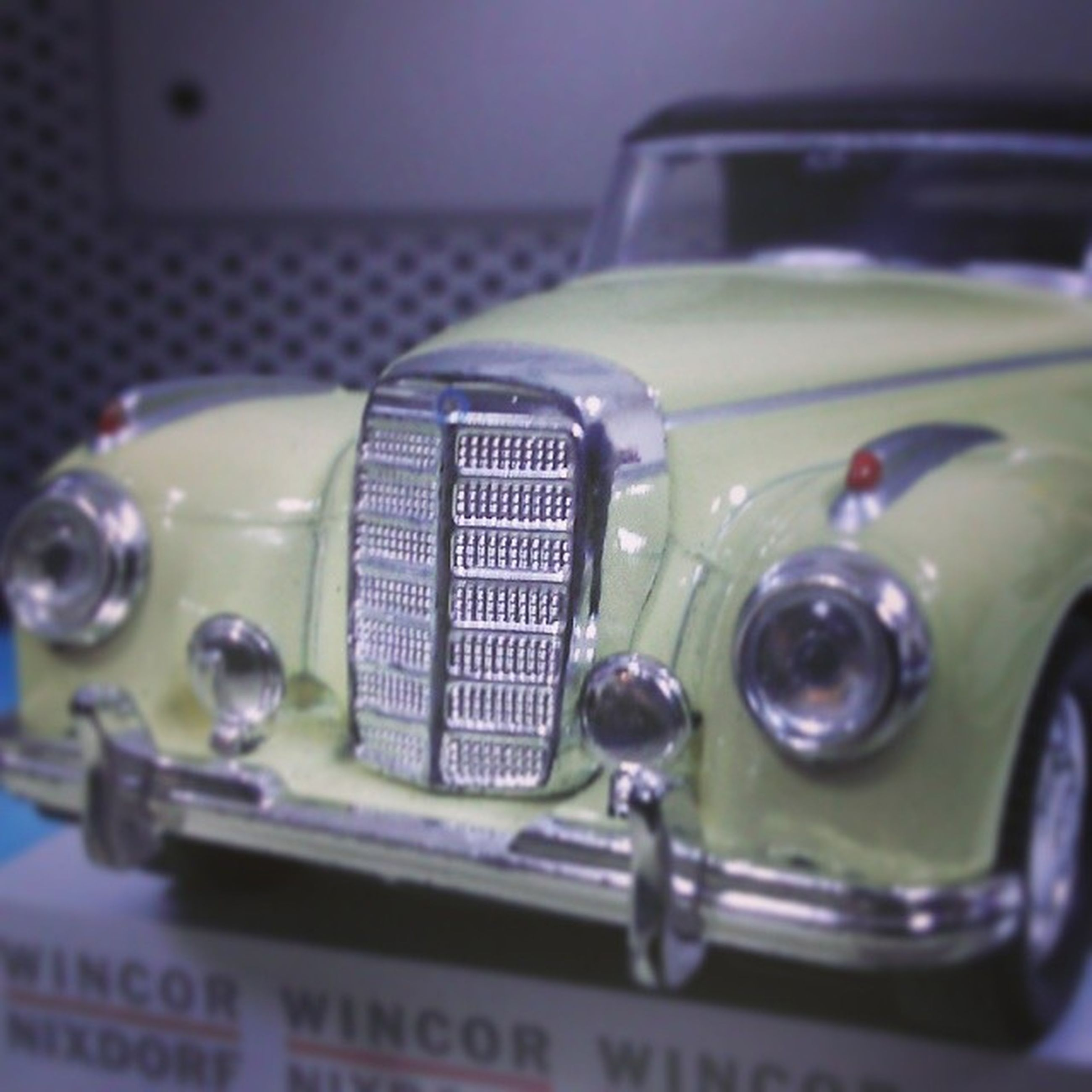 indoors, close-up, car, land vehicle, still life, technology, focus on foreground, selective focus, mode of transport, transportation, no people, toy, table, retro styled, reflection, shiny, glass - material, stationary, part of, old-fashioned